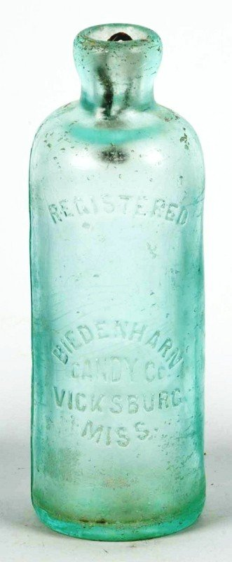 24: Glass Biedenharn Candy Company Hutch Bottle.