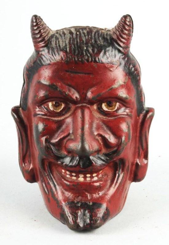 488: Cast Iron 2-Faced Devil Still Bank.