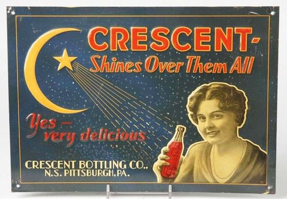 22: Tin over Cardboard Crescent Advertising Sign.