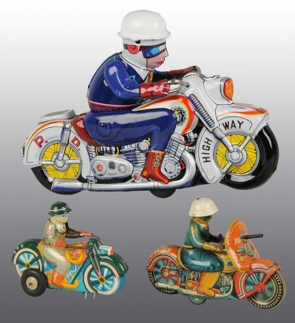 21: Lot of 3: Tin Litho Motorcycle Toys.