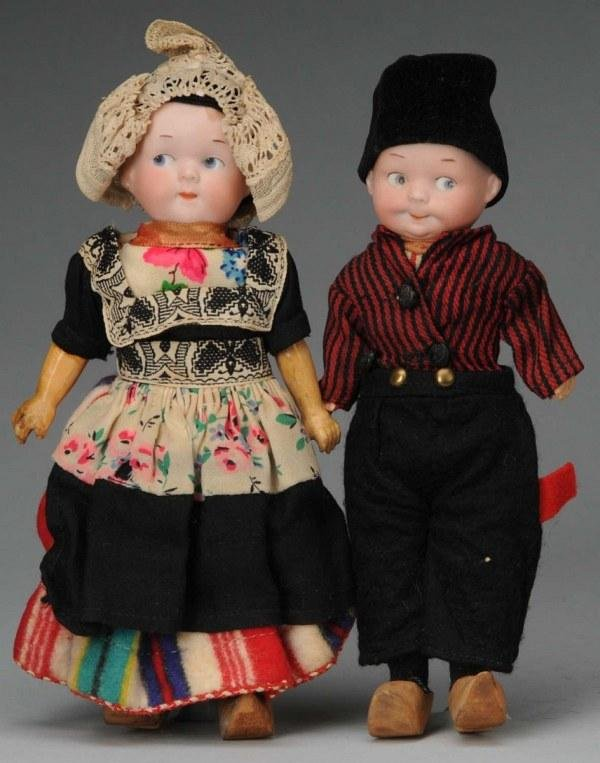 909: Lot of 2: Bisque Armand Marseille Googly Dolls.