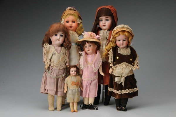 919: Lot of 6: Dolls in Original Factory Clothing.