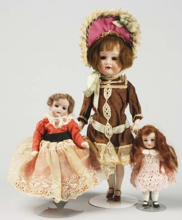 4: Lot of 3: Bisque Child Dolls.