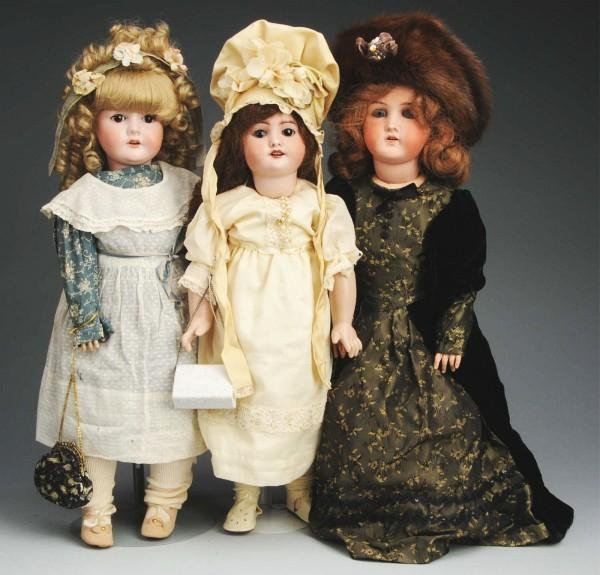 7: Lot of 3: Bisque Child Dolls.