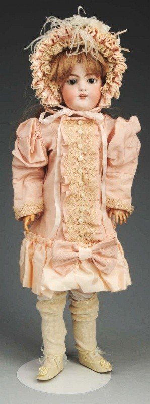 11: German Bisque Child Doll.