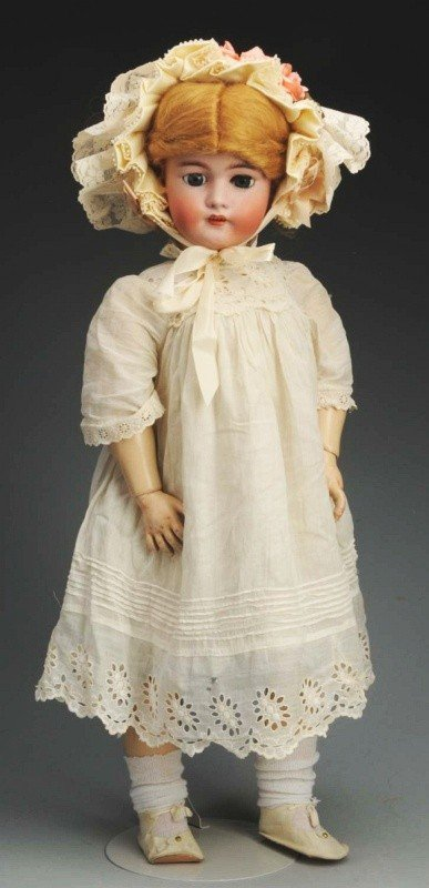 12: German Bisque Child Doll.