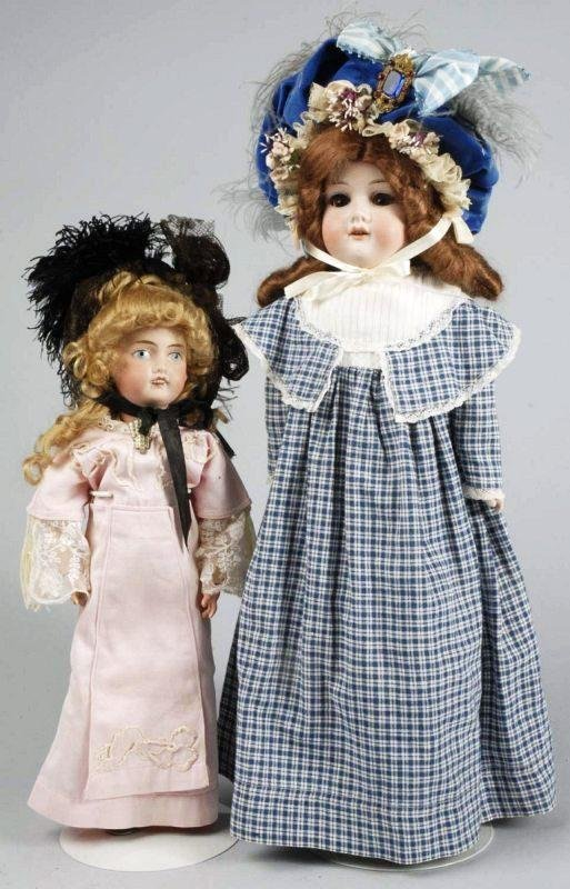 63: Lot of 2 Bisque Dolls.