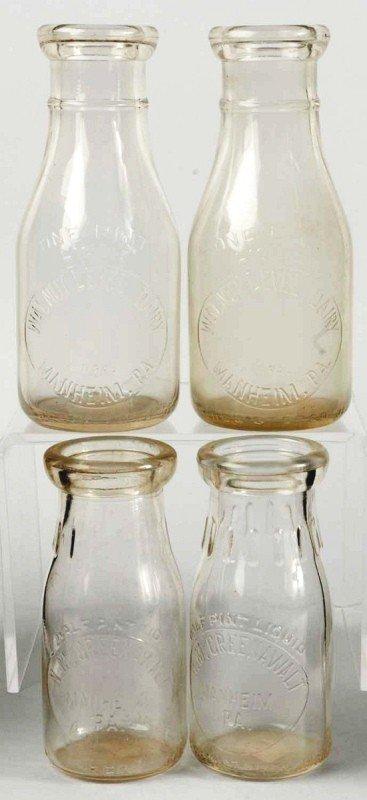 9: Lot of 4: Walnut Level Dairy Milk Bottles.