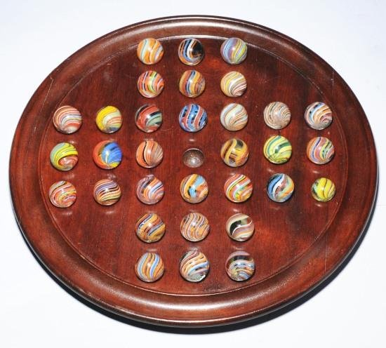 16: Solitaire Board of 32 Joseph Coat Swirl Marbles.