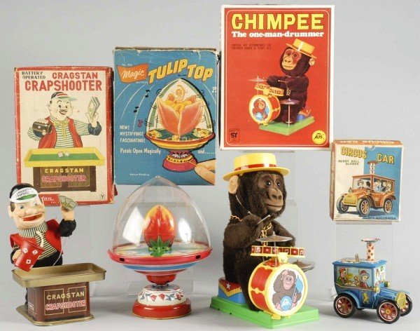13: Lot of 4: Wind-Up & Battery-Operated Toys.