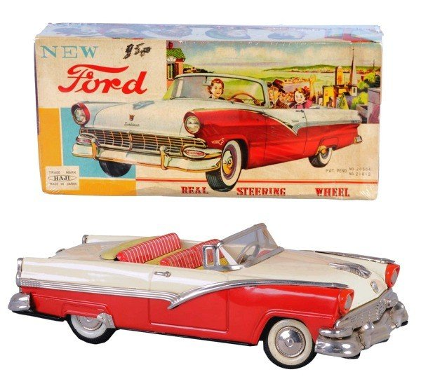 24: Tin 1956 Haji Ford Sunliner Friction Toy.