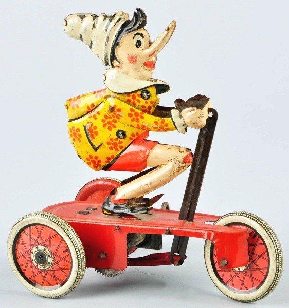 331: Tin Litho Ingap Pinocchio Scooter Wind-Up Toy.
