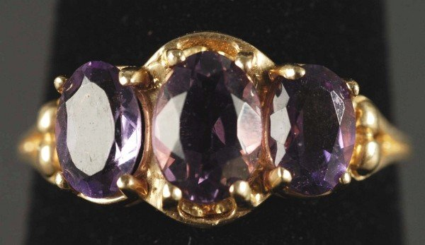 3: 10K Gold Ring with 3 Amethysts.