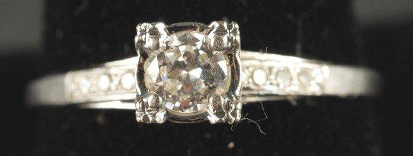 8: 18K W. Gold Diamond Ring.
