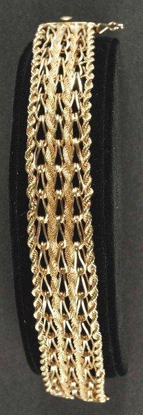 16: 14K Gold Wide Bracelet.