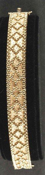 19: 14K Gold Bracelet with Weave Pattern.
