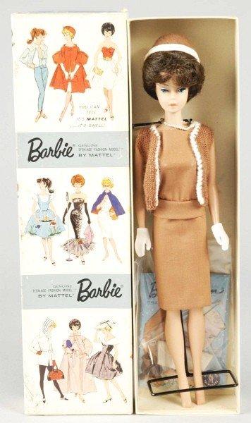 810: Brunette Dressed Boxed Bubble Cut Barbie Doll.