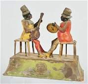 1255: Tin Gunthermann Musician Clockwork Toy.