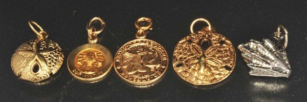 3: Lot of 5: 14K Y. Gold Charms.