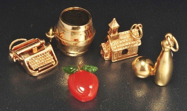 4: Lot of 5: 14K Y. Gold Charms.