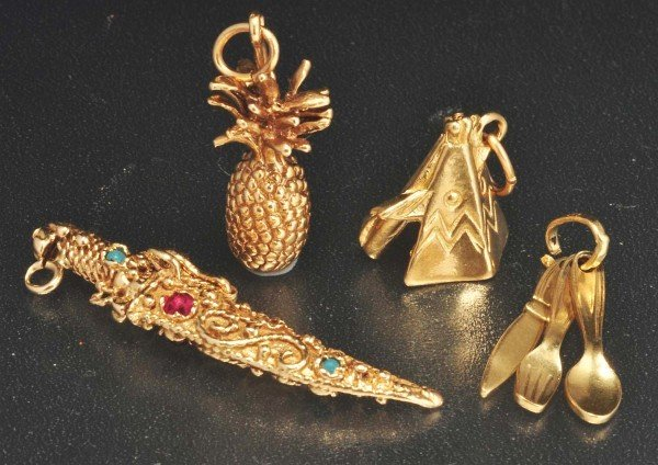 5: Lot of 4: 10K Y. Gold Charms.