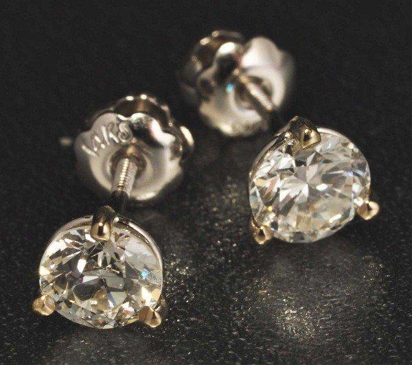 11: Pair of 14K W. Gold Diamond Earrings.