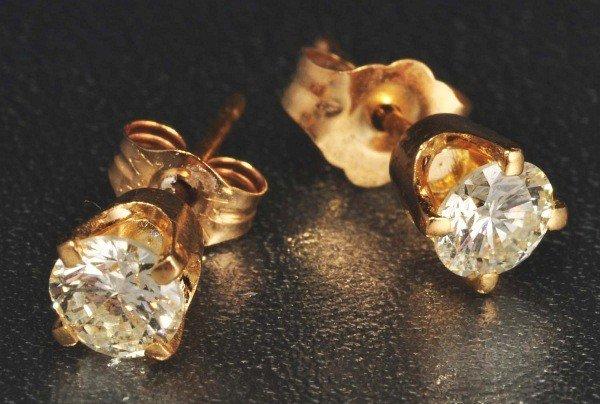 13: Pair of 14K Y. Gold Diamond Earrings.