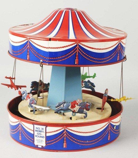 309: Tin Litho Wolverine Merry Go Round Toy.