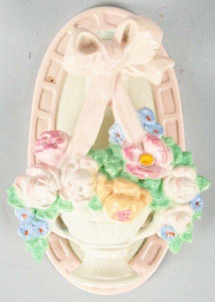1003: Cast Iron Mixed Flowers in a Vase Doorknocker.