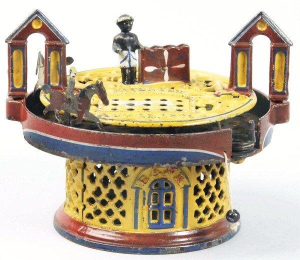 1189: Cast Iron Horse Race Mechanical Bank.