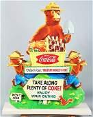 1394: 1950s Cardboard Coca-Cola Smokey Spectacular.