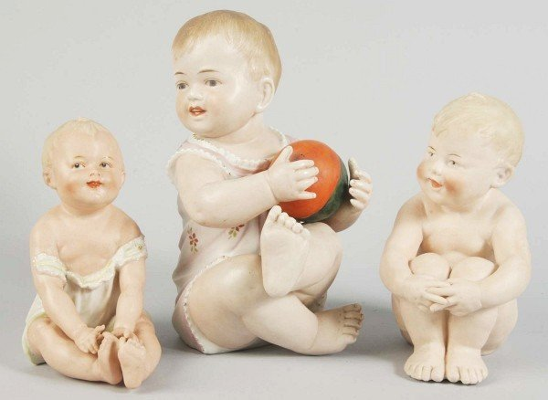 10: Lot of 3: German Bisque Piano Baby Figurines.
