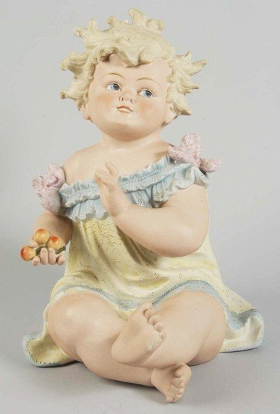 11: Large Bisque Piano Baby Figurine.