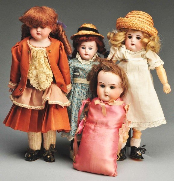 19: Lot of 4: Small Bisque Head Dolls.