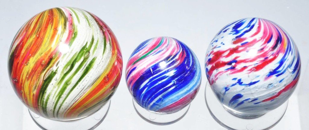 22: Lot of 3: Four-Paneled Onionskin Marbles.