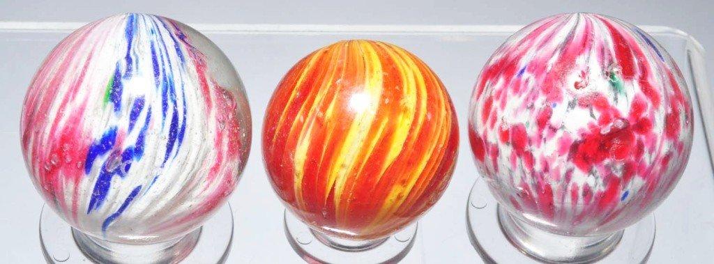 23: Lot of 3: Onionskin Marbles.