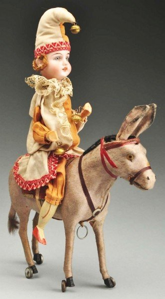 4: Bisque Head Clown on Donkey Pull Toy.