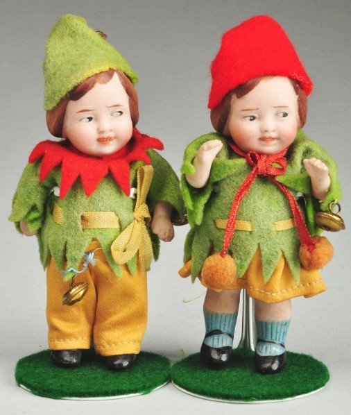 13: Pair of German All Bisque Dolls.