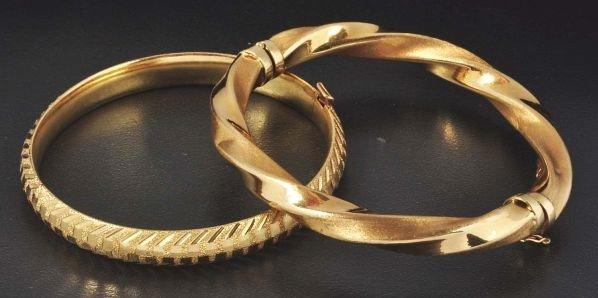21: Lot of 2: 10K Y. Gold Hinged Bracelets.
