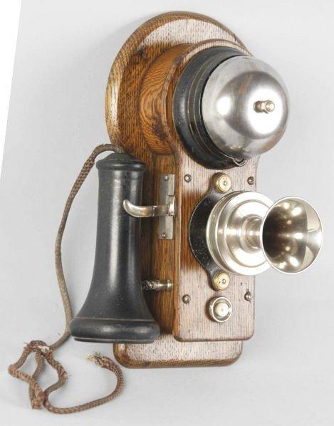 629: Oak Ericsson Wall Telephone. - 2