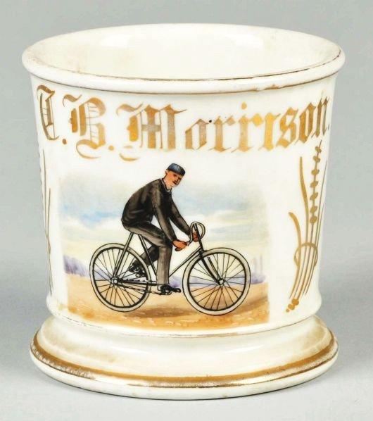 12: Man Riding Bicycle Shaving Mug.