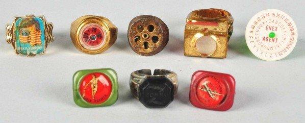 716: Lot of 8: Character & Premium Rings.