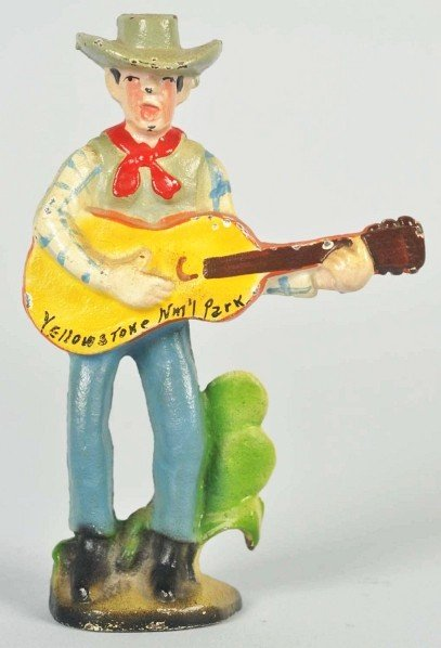 1419: Cast Iron Cowboy with Guitar Bottle Opener.