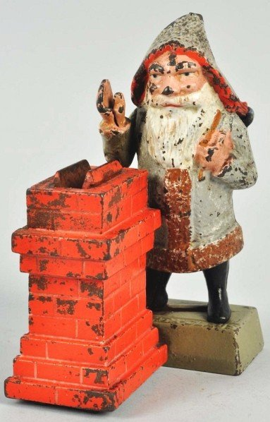 1560: Cast Iron Santa Claus Mechanical Bank.
