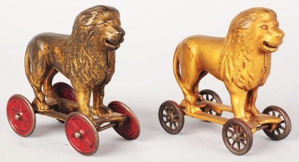 715: Lot of 2: Cast Iron Lion on Wheels Still Banks.