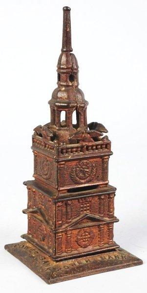 733: Cast Iron Tower Still Bank.