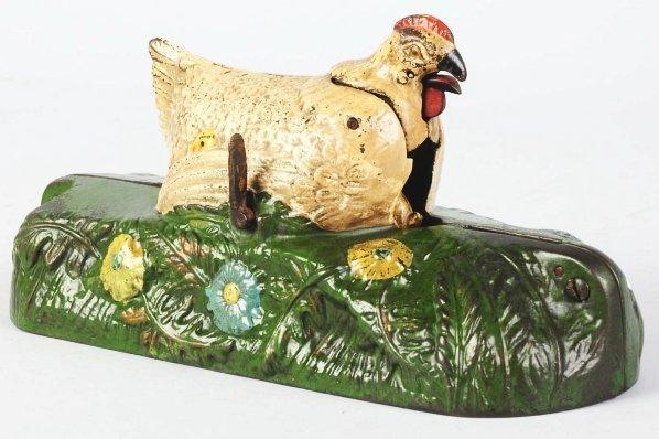 856: Cast Iron Hen & Chick Mechanical Bank.