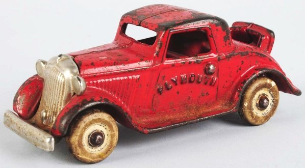 912: Cast Iron Plymouth Roadster Toy. - 2