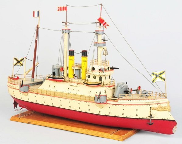 1163: Hand-Painted Tin Petropavlovsk Boat Toy.