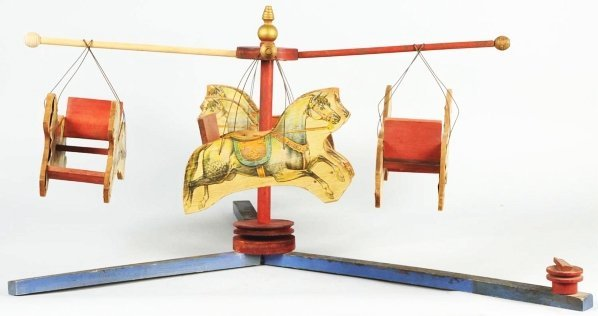 1165: Early Paper on Wood Carousel Toy.
